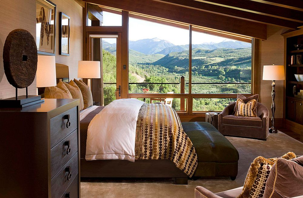 Bedroom of the vacation home with sloped ceiling and unabated mountain views