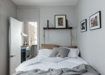 Black and white prints inside the small bedroom accentuate the monochromatic look