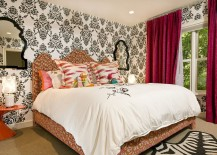 Black and white wallpaper and red drapes for the bright bedroom
