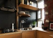 Black subway tile backsplash in a modern kitchen
