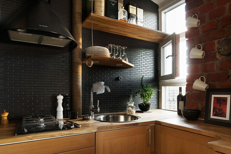 Black subway tile backsplash in a modern kitchen