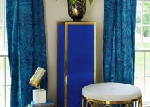 Blue Lucite pedestal table from Jonathan Adler