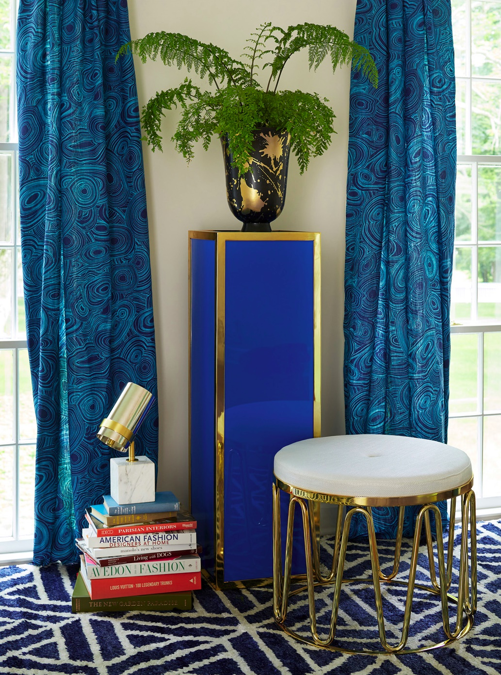 Blue Lucite pedestal table from Jonathan Adler