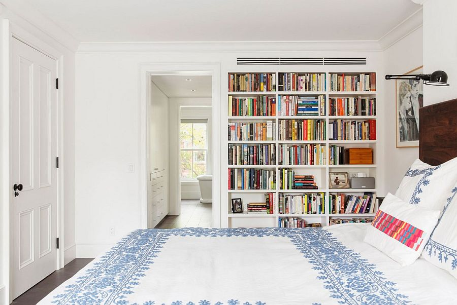 Bookshelf adds color and contrast to the all-white bedroom