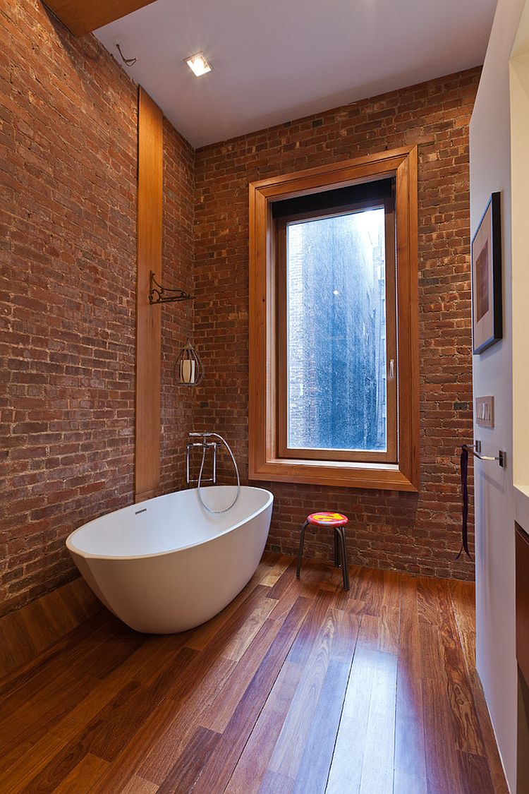 brick and wood create an elegant industrial bathroom decoist. Black Bedroom Furniture Sets. Home Design Ideas