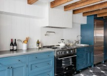Cabinets in blue add color to the spacious kitchen
