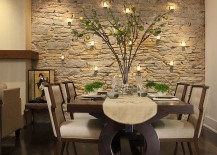 Candles highlight the beauty of the stone wall in the dining room 217x155 Fitting in with Every Style: Gorgeous Dining Rooms with Stone Walls