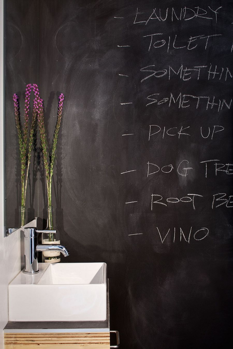 Chalkboard walls in the bathroom make for a fun and dynamic surface