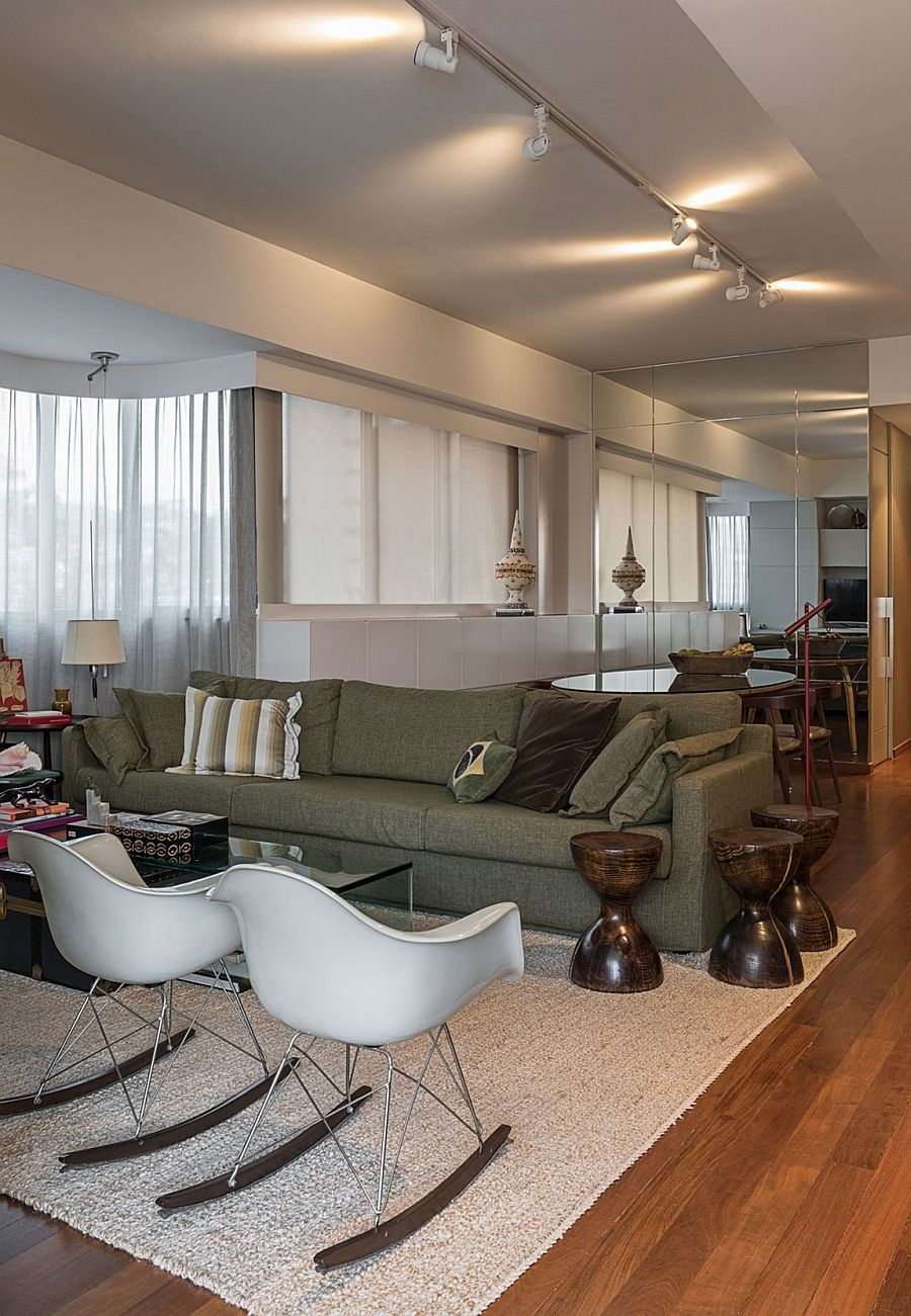 Classic Eames rockers, fun side tables and a plush couch sit in the new living area