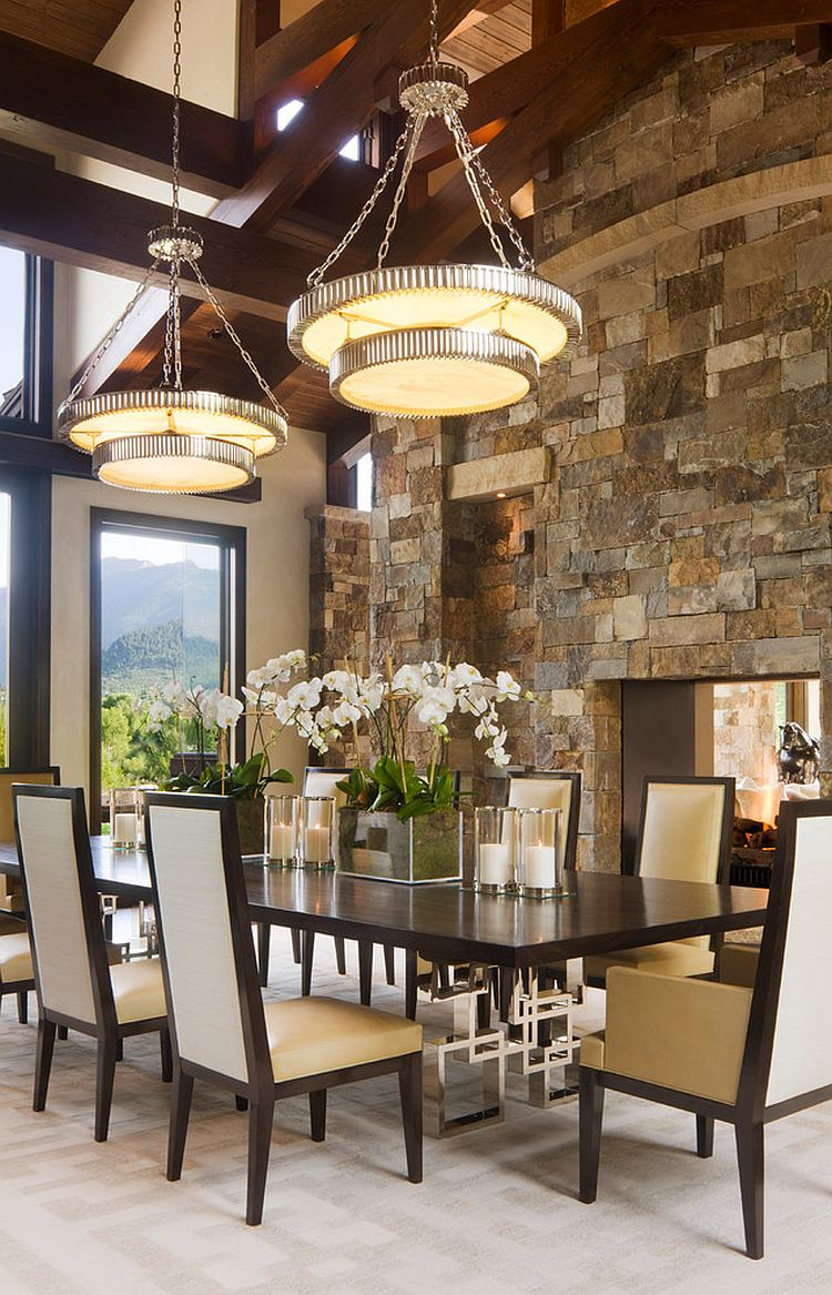 Classy contemporary dining room with stone fireplace [Design: Charles Cunniffe Architects Aspen]