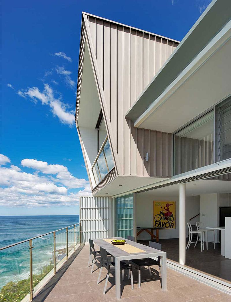 Contemporary beach residence with a balcony that overlooks the ocean