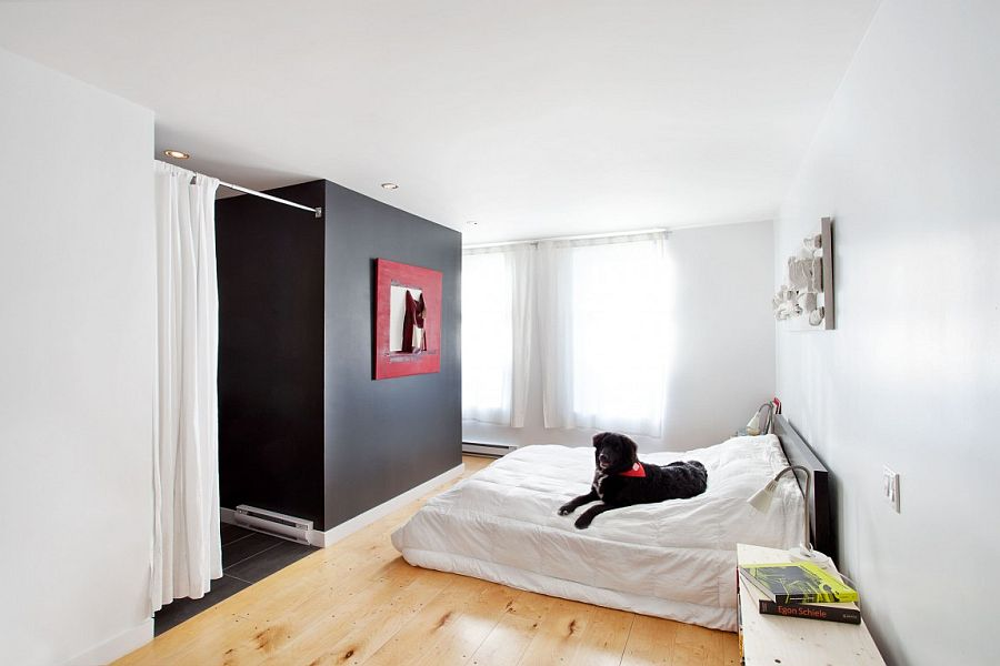 Contemporary bedroom in white with a black accent feature
