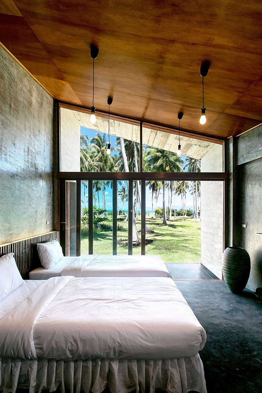 Contemporary bedroom with sea view at the Somjai House
