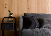 Contemporary-couch-in-gray-and-minimal-decor-grace-the-stylish-apartment-217x155