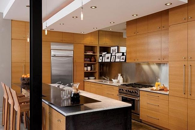 Contemporary kitchen draped in wood