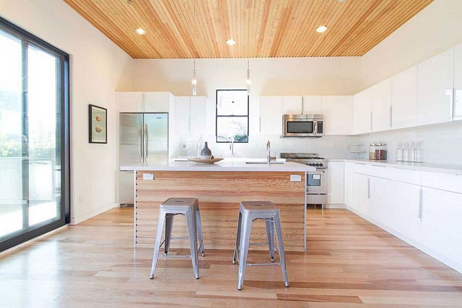 Contemporary kitchen in white with a wooden ceiling