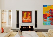Contemporary minimal interior of NYC apartment with marble fireplace and colorful wall art