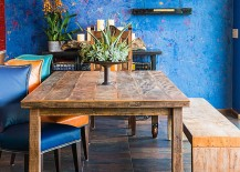 Cool blue textured wall is the showstopper in this relaxing, casual dining room