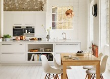 Copper-and-stainless-steel-in-an-airy-modern-kitchen-217x155