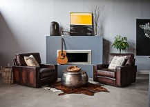 Cozy sitting nook next to the contemporary fireplace with smart mantel decorations