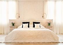 Cream draperies in an elegant bedroom