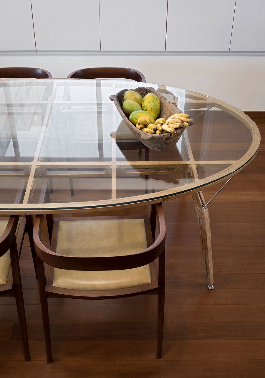 Custom dining table from the 50s sits in the modern Brazilian penthouse