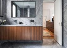 Custom floating wooden vanity with stone countertop