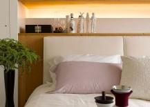 Custom-headboard-wall-with-built-in-shelf-and-lovely-lighting-217x155