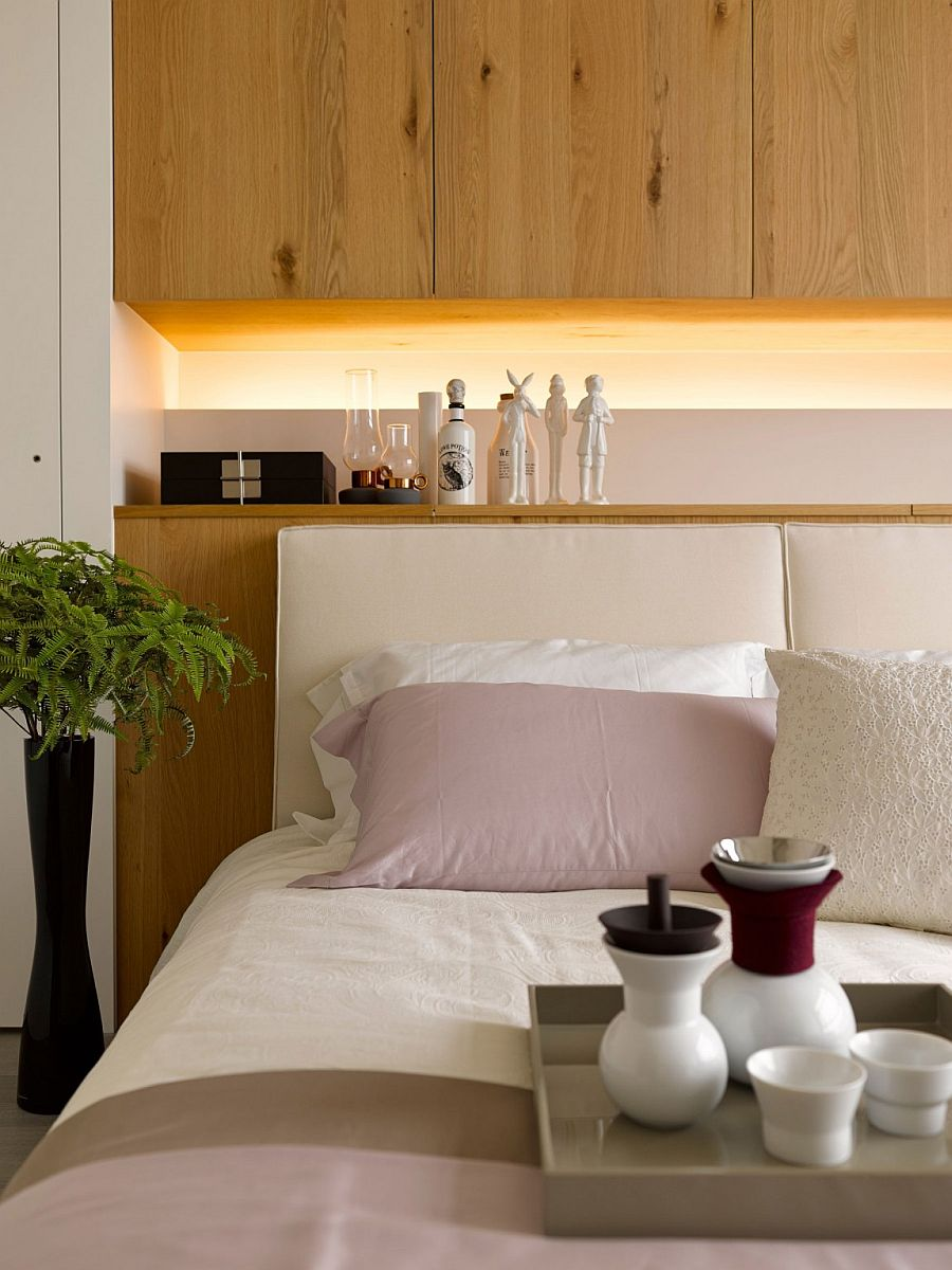 Custom headboard wall with built-in shelf and lovely lighting
