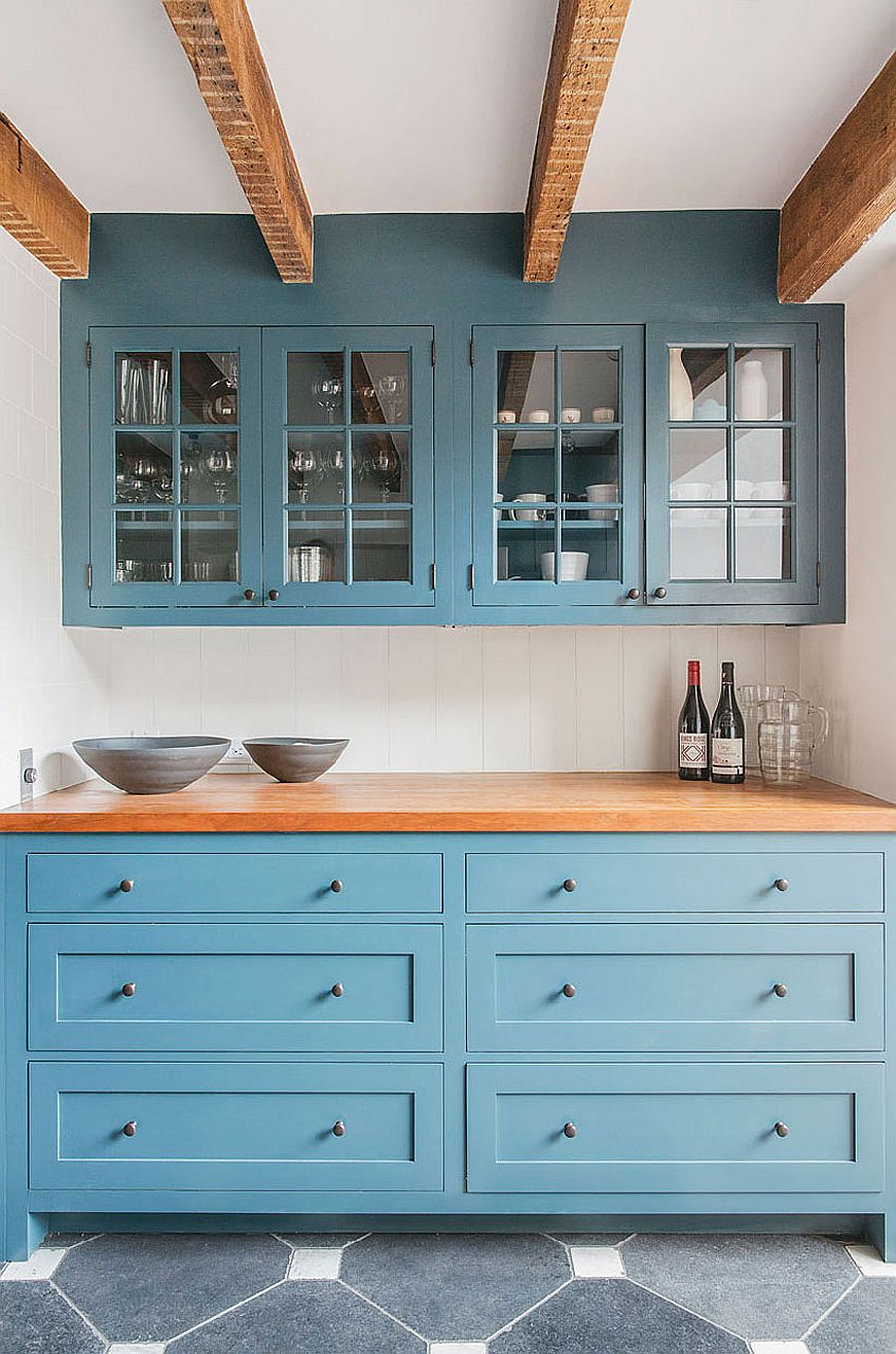 Custom kitchen cabinets in blue and wooden worktop