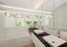 Custom-made vanity in a crisp, modern bathroom