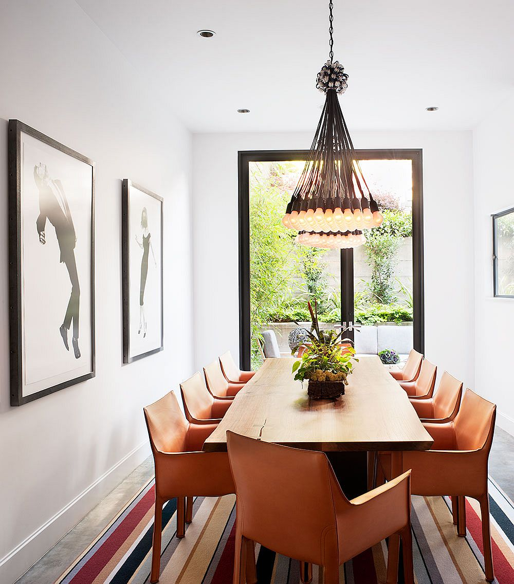 Dancing Partners by Robert Longo and gorgeous 85 Lamps in the stylish dining room