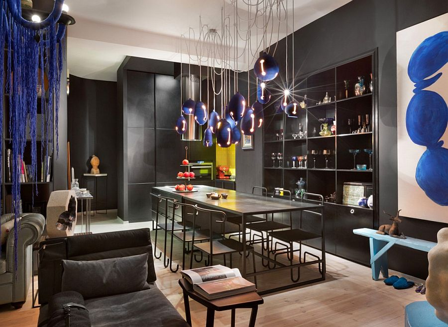 Dark and colorful dining room ends up becoming the showstopper of the apartment