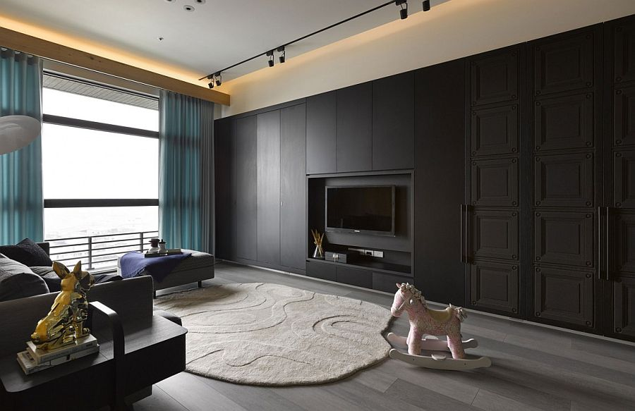 Dark living room wall with cabinets and wall mounted TV Small Apartment in Taipei City Embraces Understated Modernity