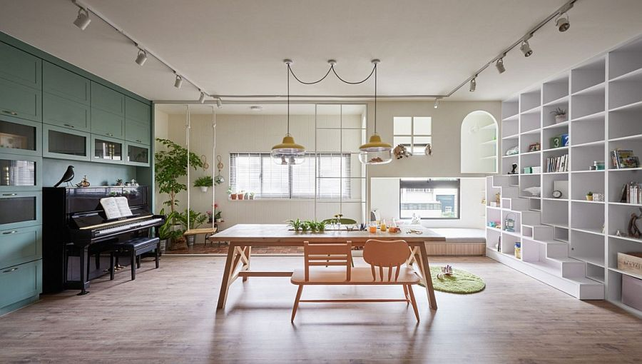 Dining room and kids' playroom with swing and ample storage space