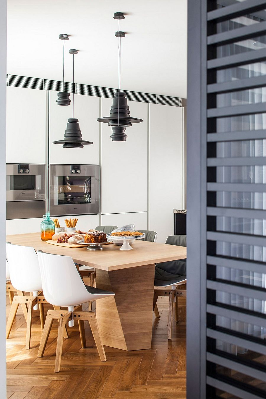 Dining table brings textural contrats to the polished interior