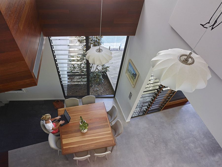 Double height spaces give the interior a spacious appeal