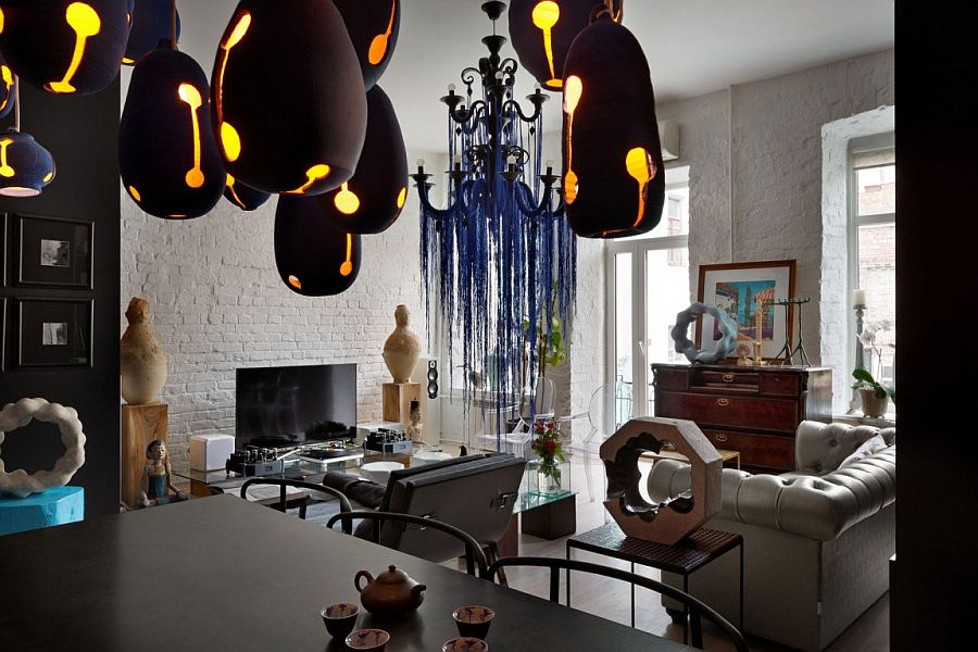 Eclectic living area with brick walls, custom decor and fun pops of color