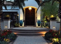 Entryway with arched date palms is the perfect way to lead into a Mediterranean home