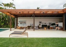 Expansive-yard-and-pool-area-of-Brazilian-home-defined-by-its-half-buried-design-217x155