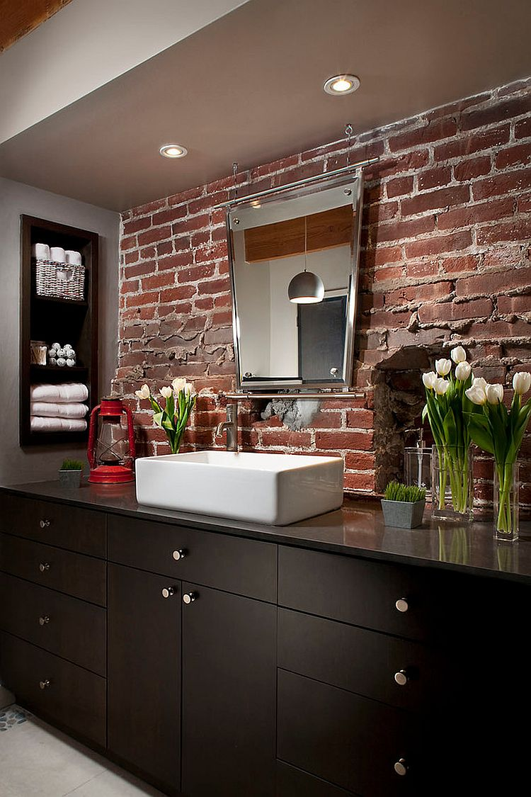 Exposed brick backsplash for the modern industrial bathroom [Design: Melissa Winn Interiors]