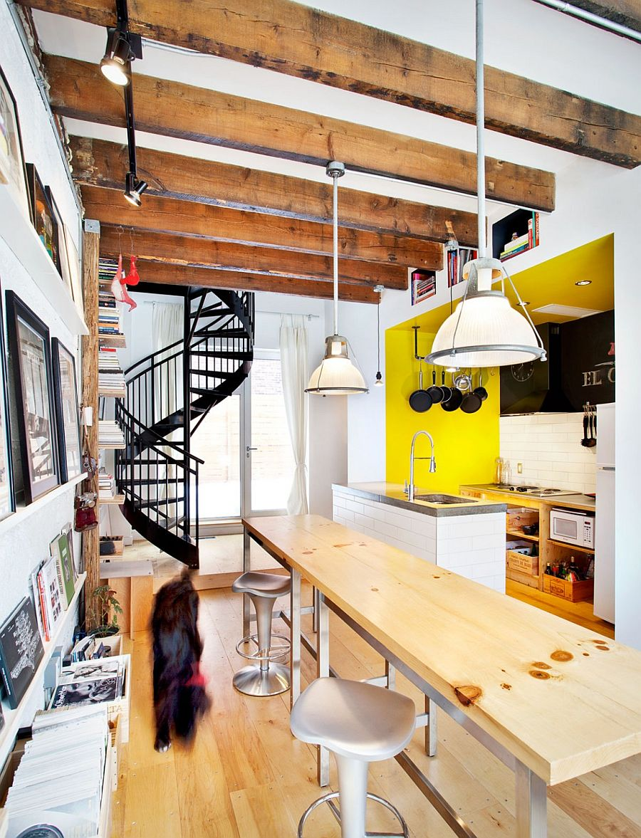 Exposed ceiling beams, spiral staircase and decor give the interior an industrial touch