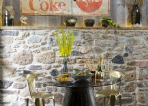 Fabulous eclectic dining room with distressed wood and stone wall