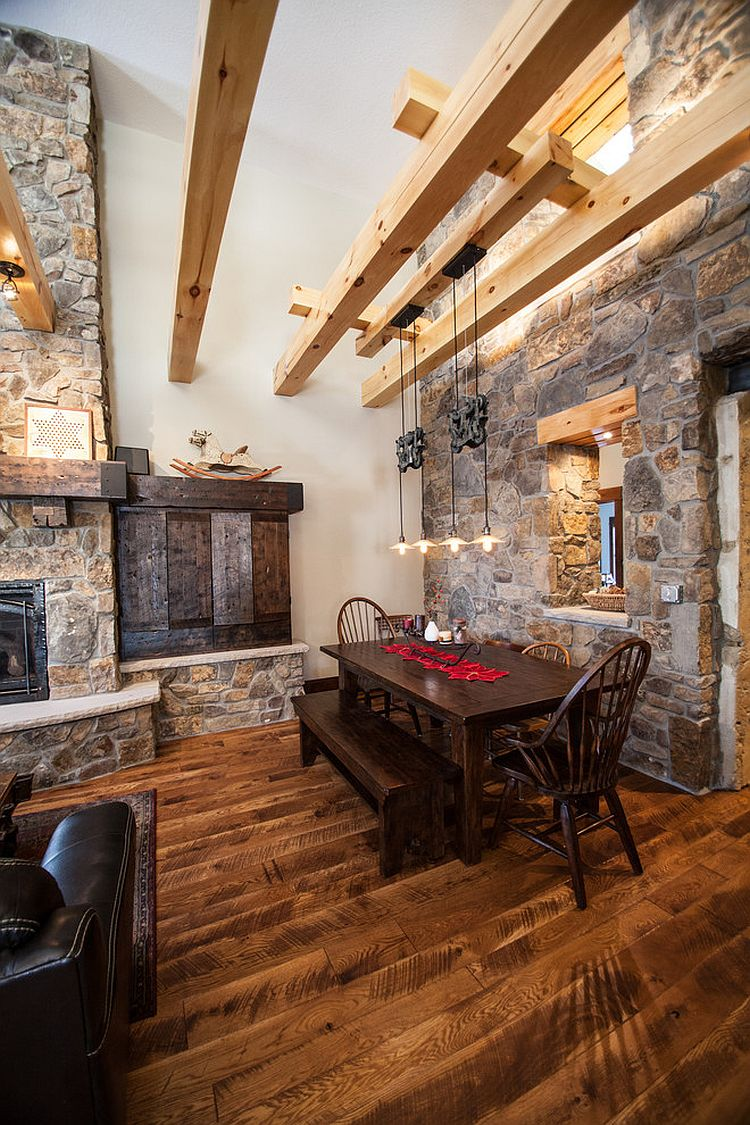 Farmhouse style dining room with wooden beams stone walls and ingenious ligh