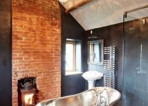 Fireplace and lighting elevate the style quotient of this gorgeous farmhouse bathroom