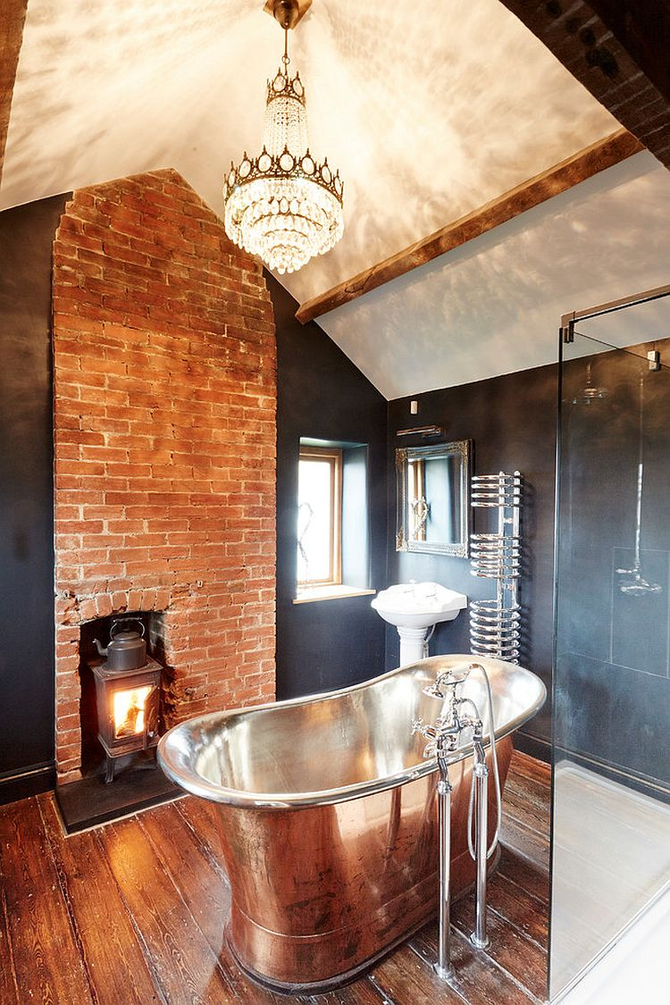 Fireplace and lighting elevate the style quotient of this gorgeous farmhouse bathroom [Design: Hart Design And Construction]