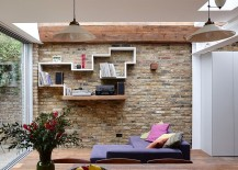 Floating modern and wooden shelf in the living room with brick wall