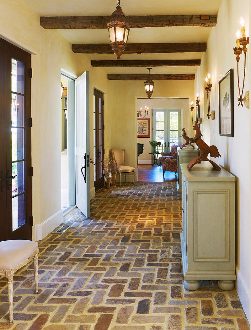 Flooring adds to the Mediterranean vibe of the entry [Design: Barnes Vanze Architects]