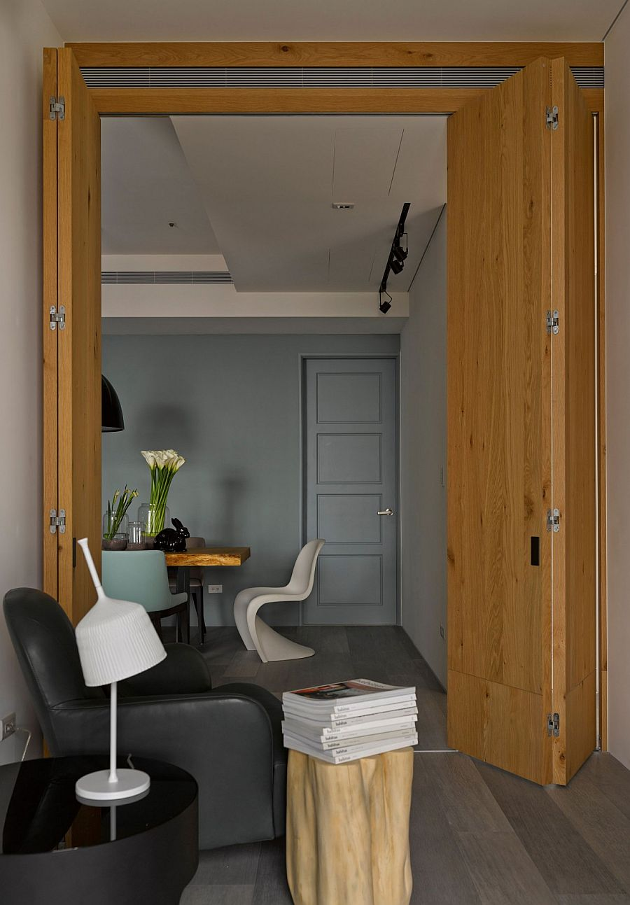 Folding wooden doors create rooms within larger living area