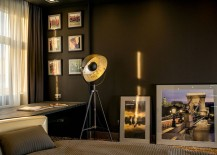 Framed photographs add to the sophisticated atmosphere inside the apartment